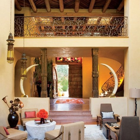 The living room is naturally illuminated with sunlight and features a Moroccan lantern