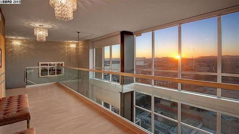 floor-to-ceiling-windows-provide-ample-light-in-the-penthouse