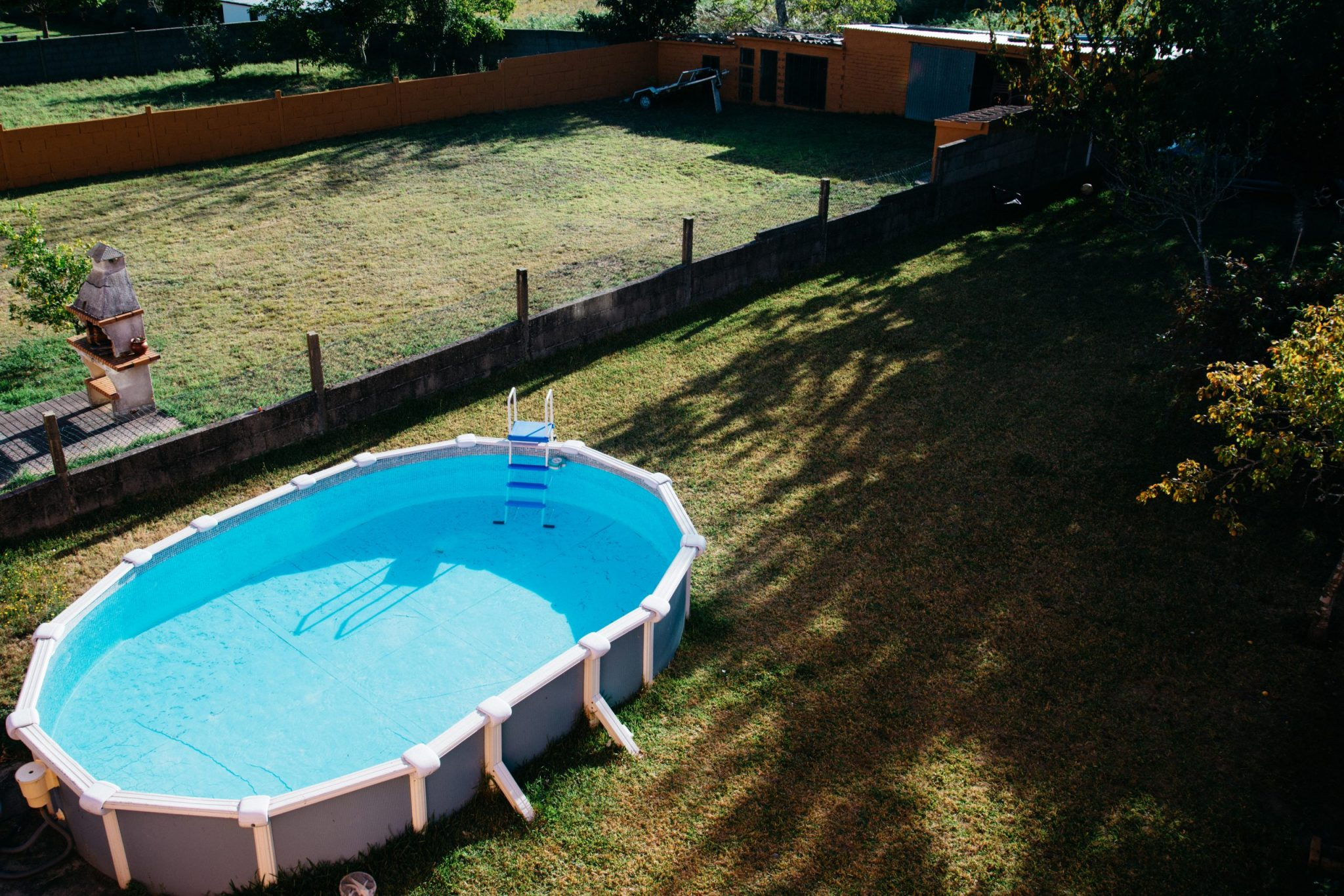 How to Design an Above-Ground Pool for your Backyard ...