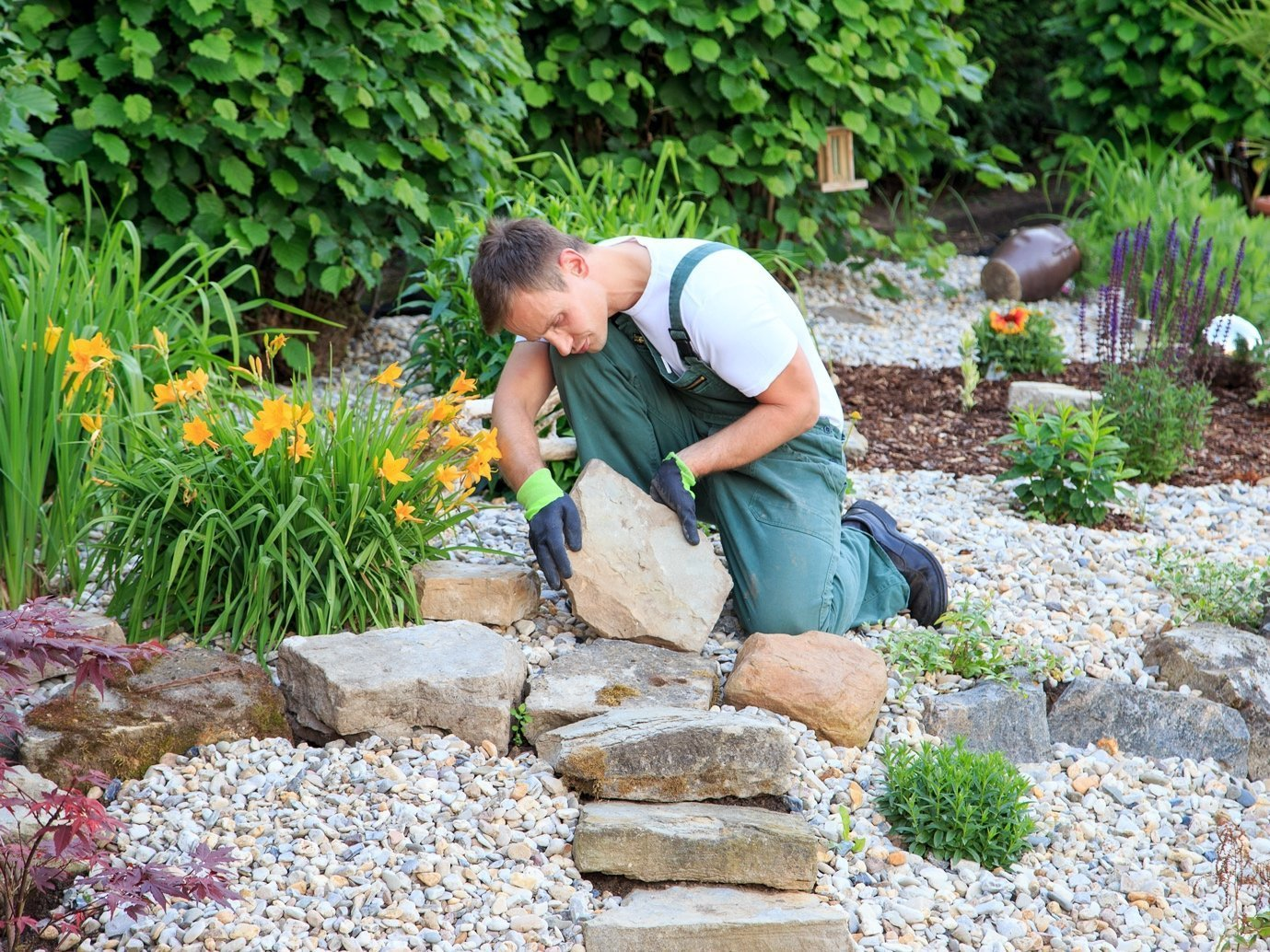 A picture containing outdoor, rock, stone, garden Description automatically generated