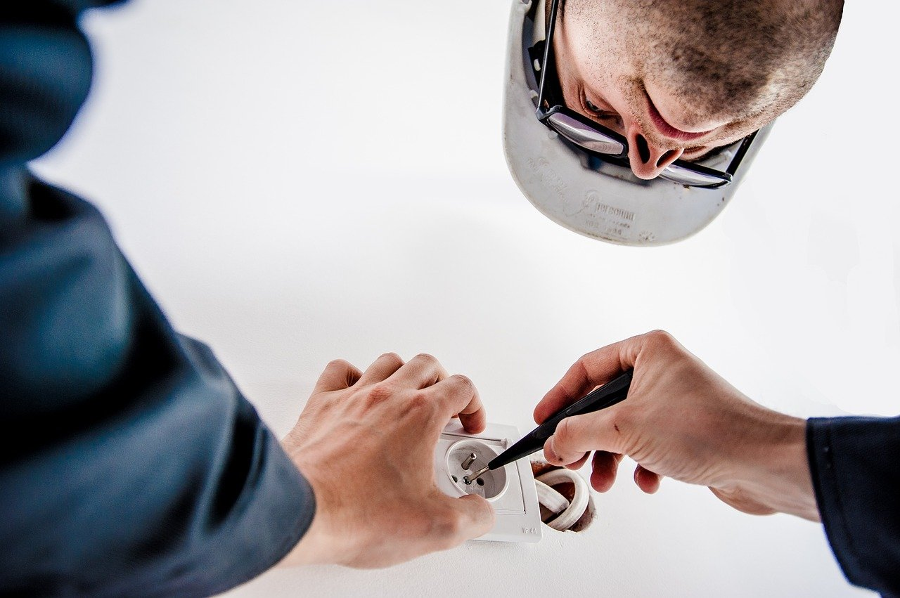 commercial electrician installing a socket